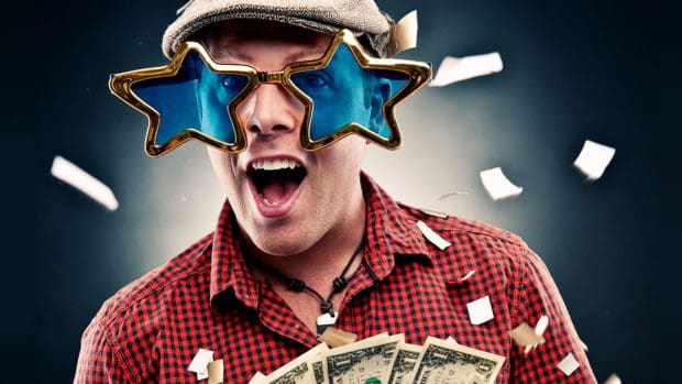 Funny Guy with Star Glasses holding some cash