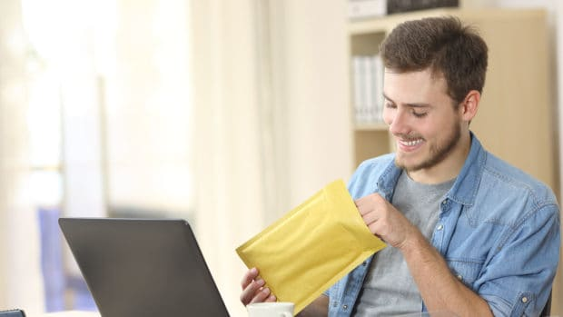 Entrepreneur opening a envelope payment