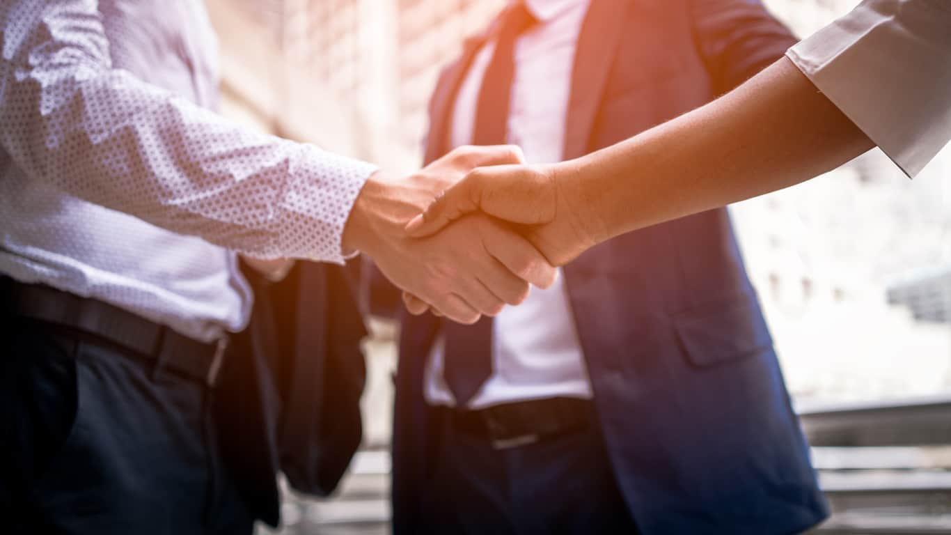 Shaking hands on a loan refinance deal