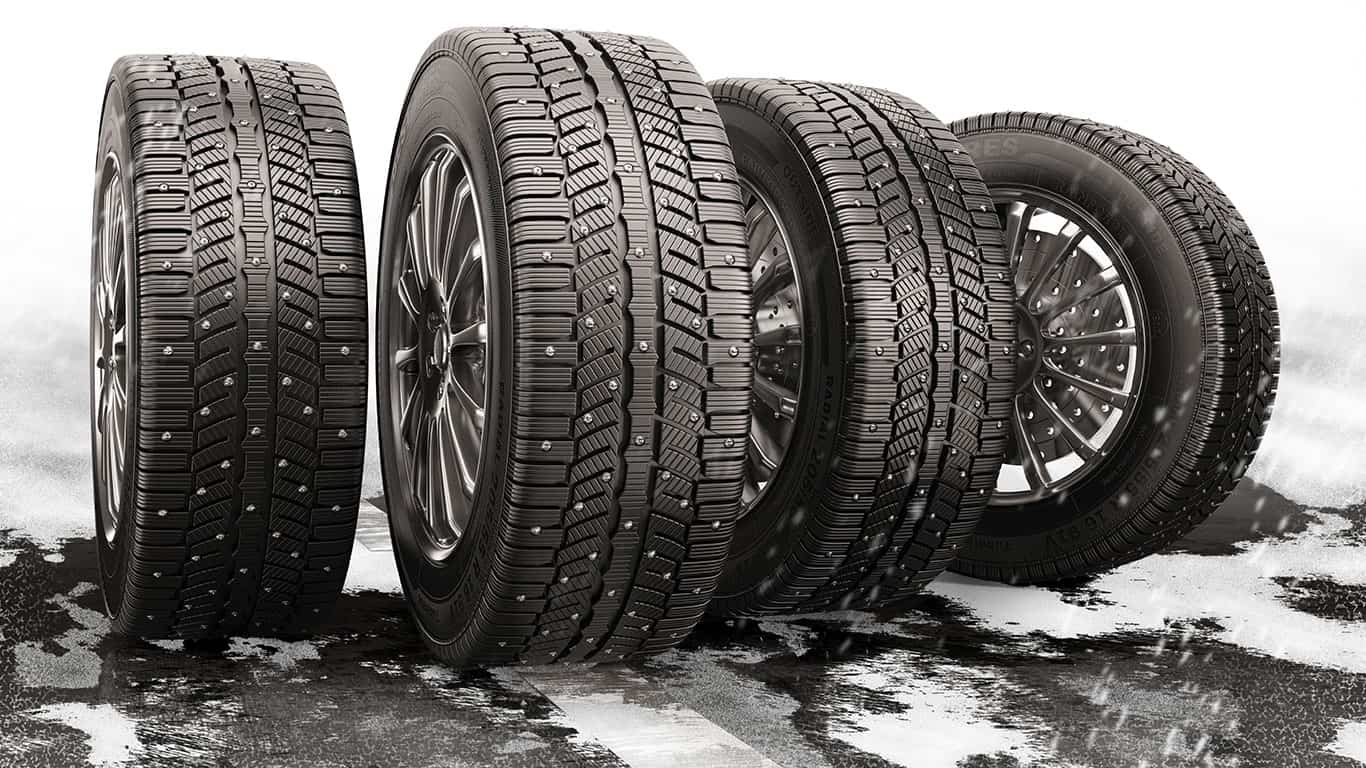 Four tires on road with snow