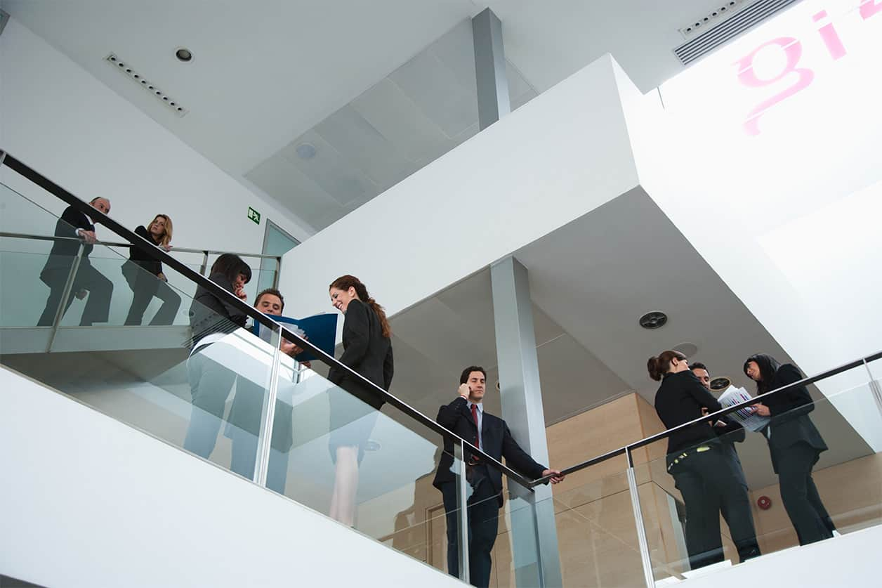 Businesspeople standing on office balcony
