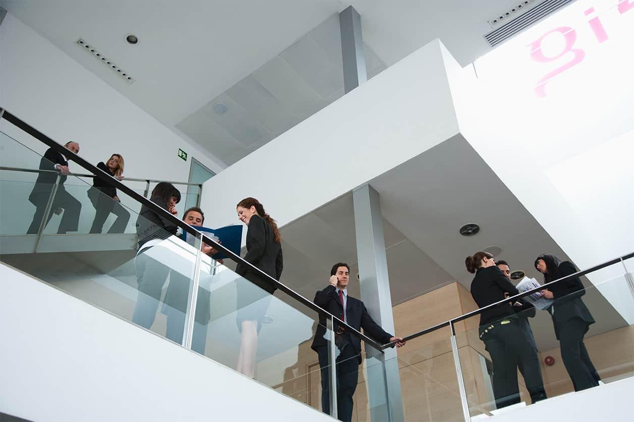 Businesspeople standing on office balcony