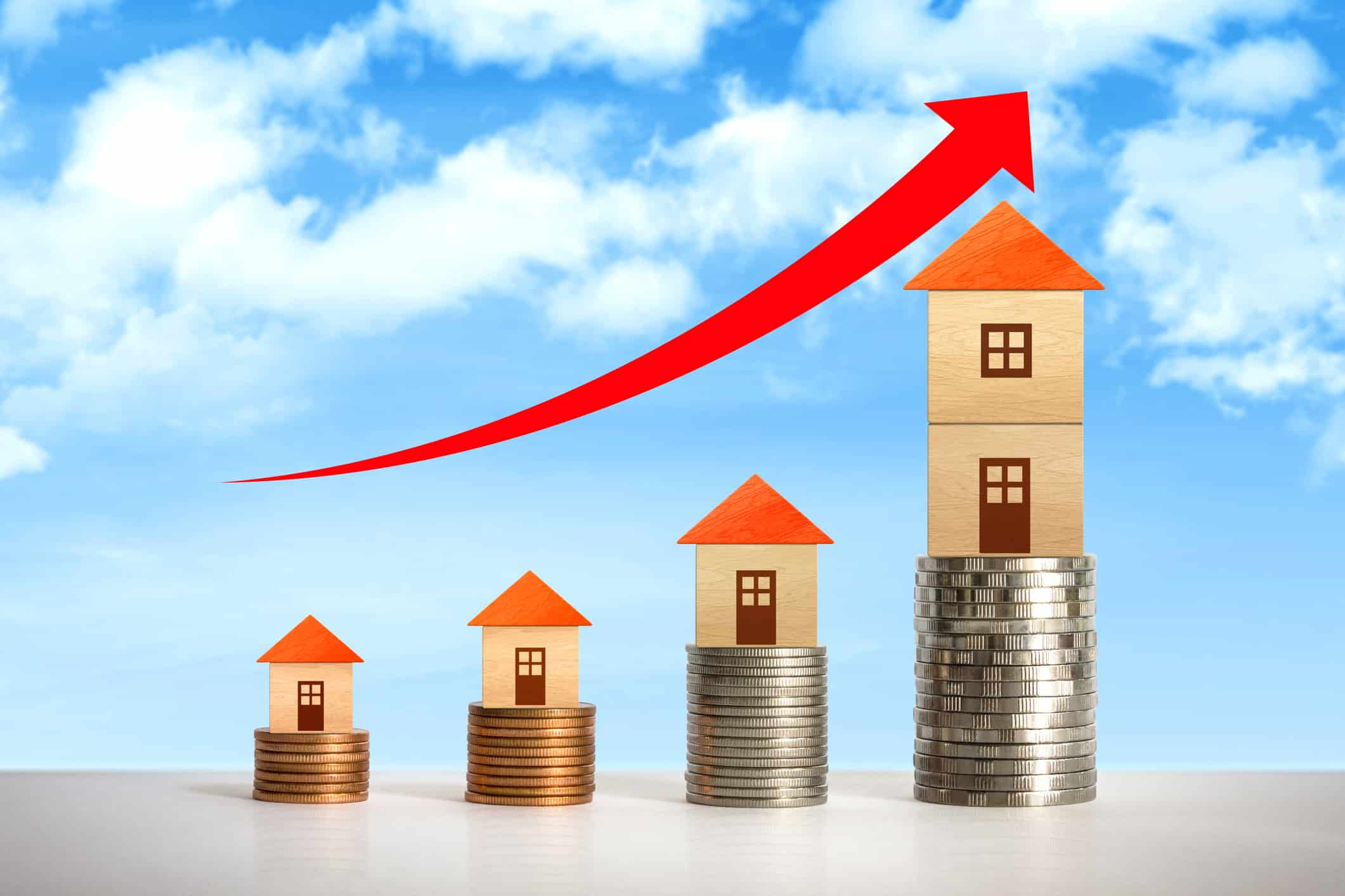 With home prices rising current homeowners Are benefiting. Image of coins stacked ascending with paper homes on top. A depiction of rising home prices.