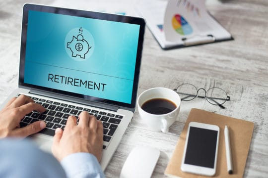 Retirement displayed on laptop. Millennial Homeowners Are Tapping Retirement savings to buy homes.