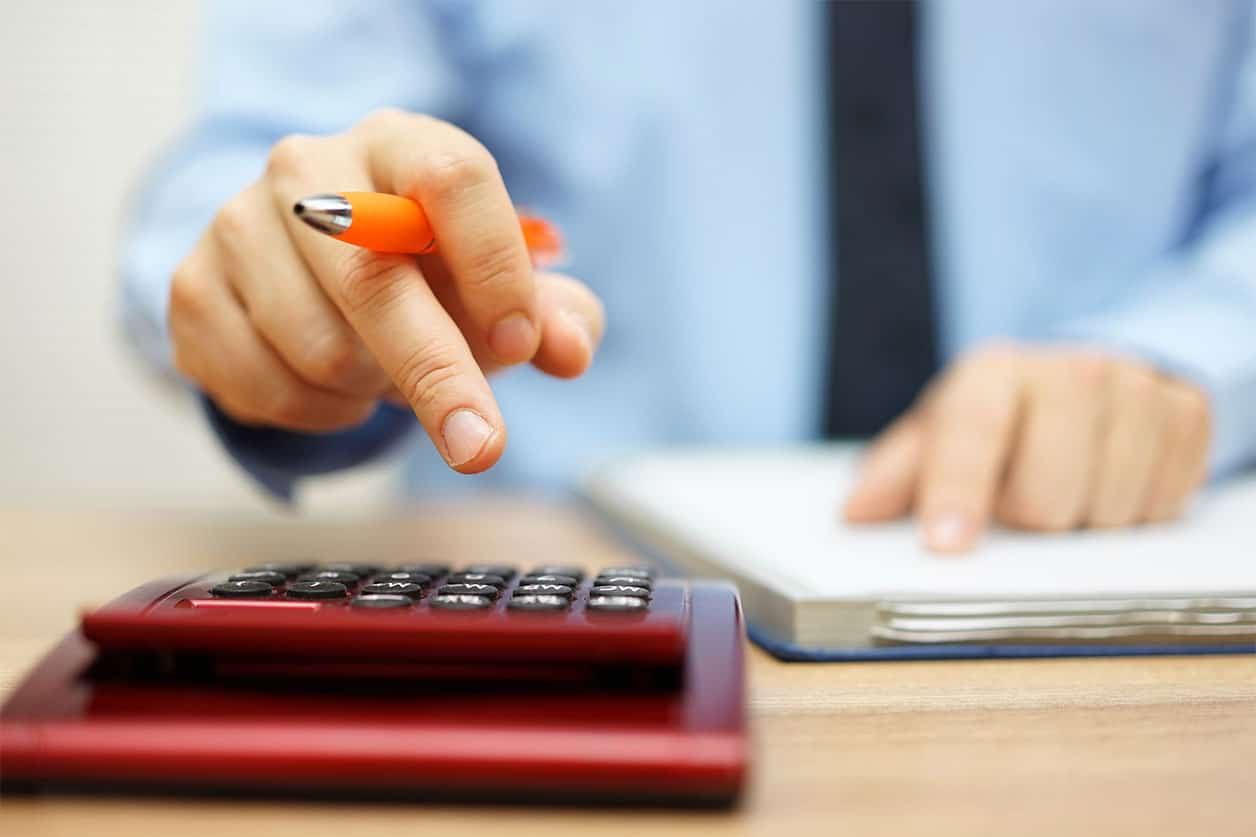 Shallow depth of field of accountant calculating financial data