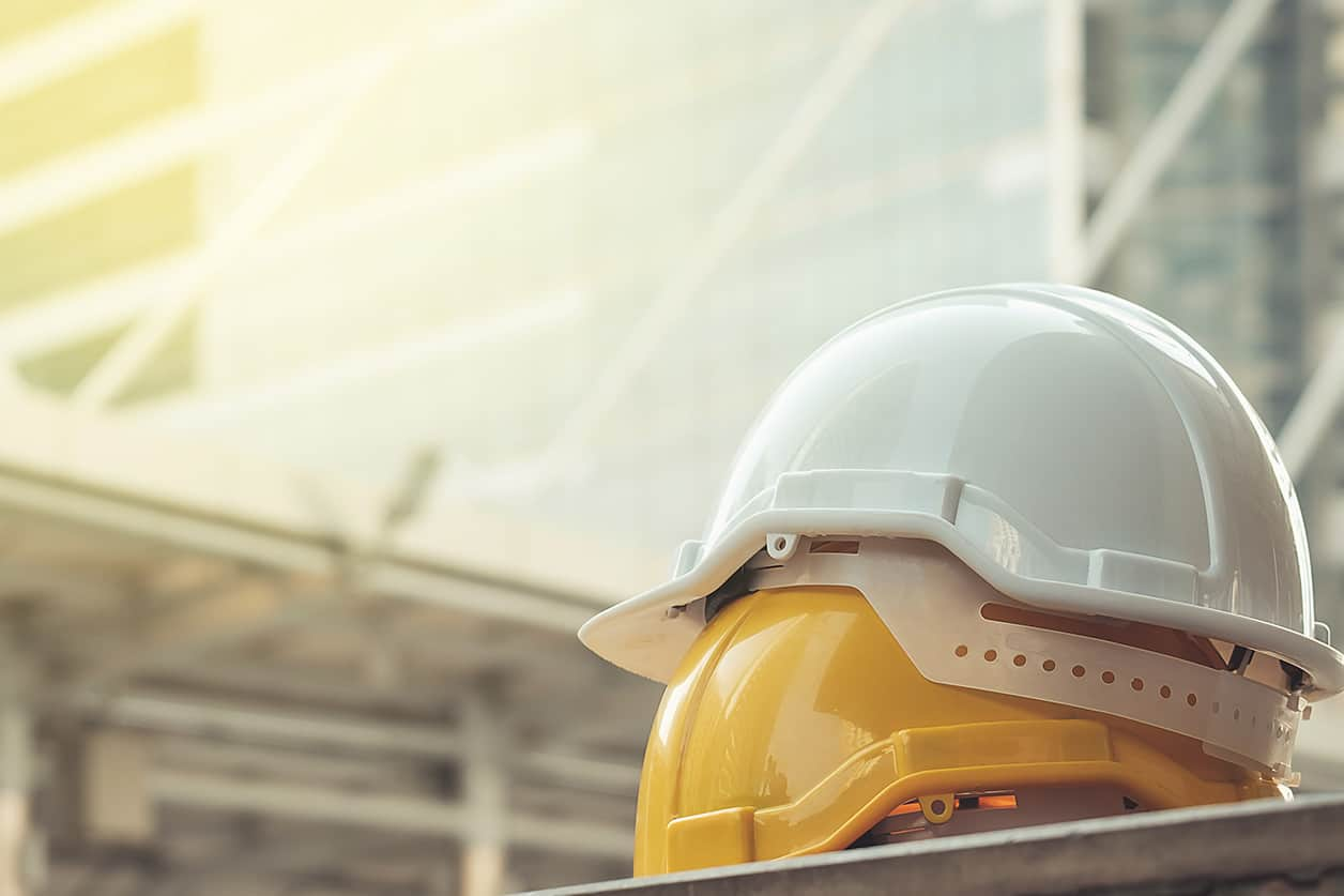 White yellow hard safety helmet. Vacation and flexibility are the benefits workers want.