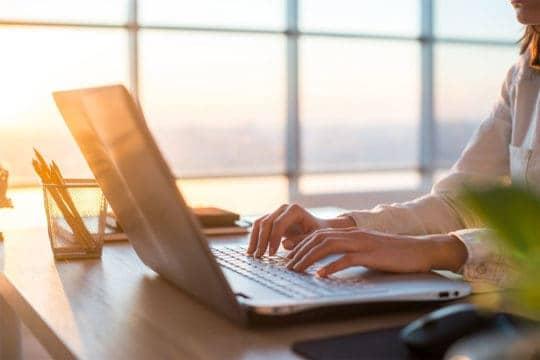 Female budgeting using laptop
