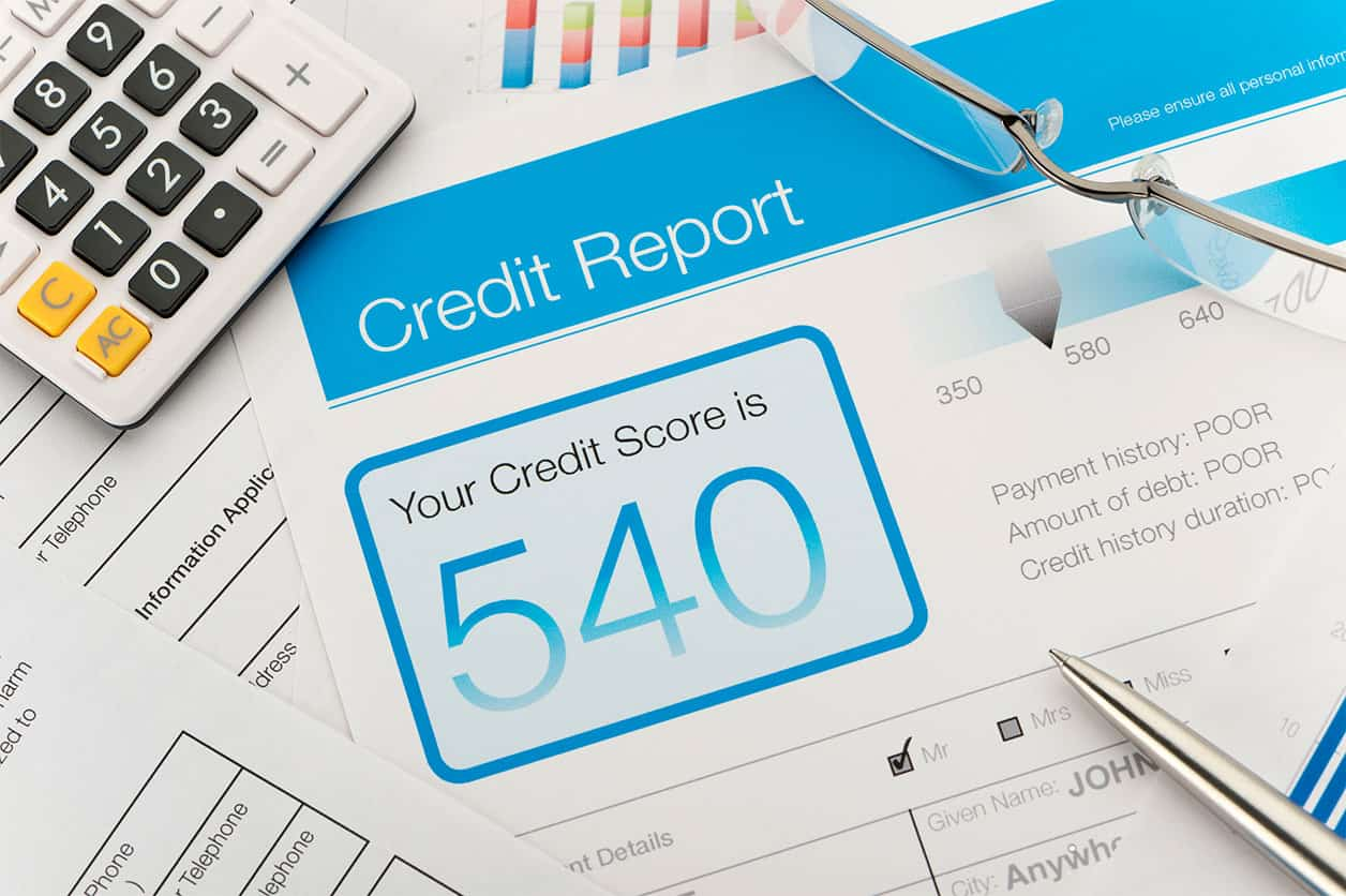 Credit report with score on a desk representing credit score stories that are troubling.