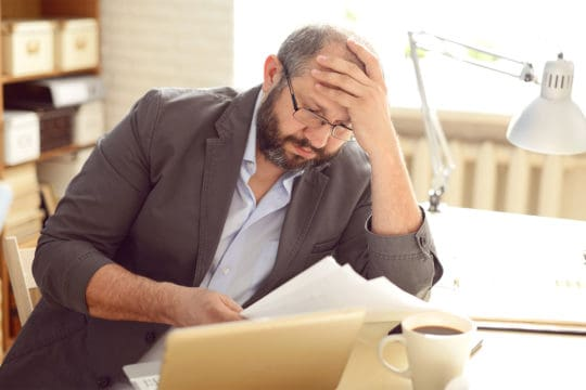 Financial stress and health: Man working in the office