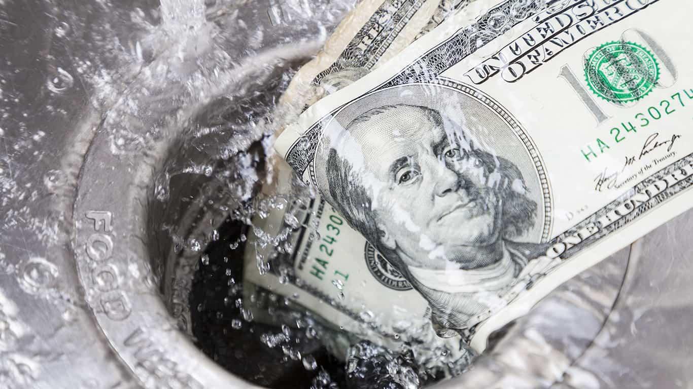 Money being washed down garbage disposal