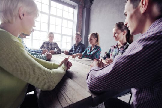 Team of people working in a focus group that pays cash.