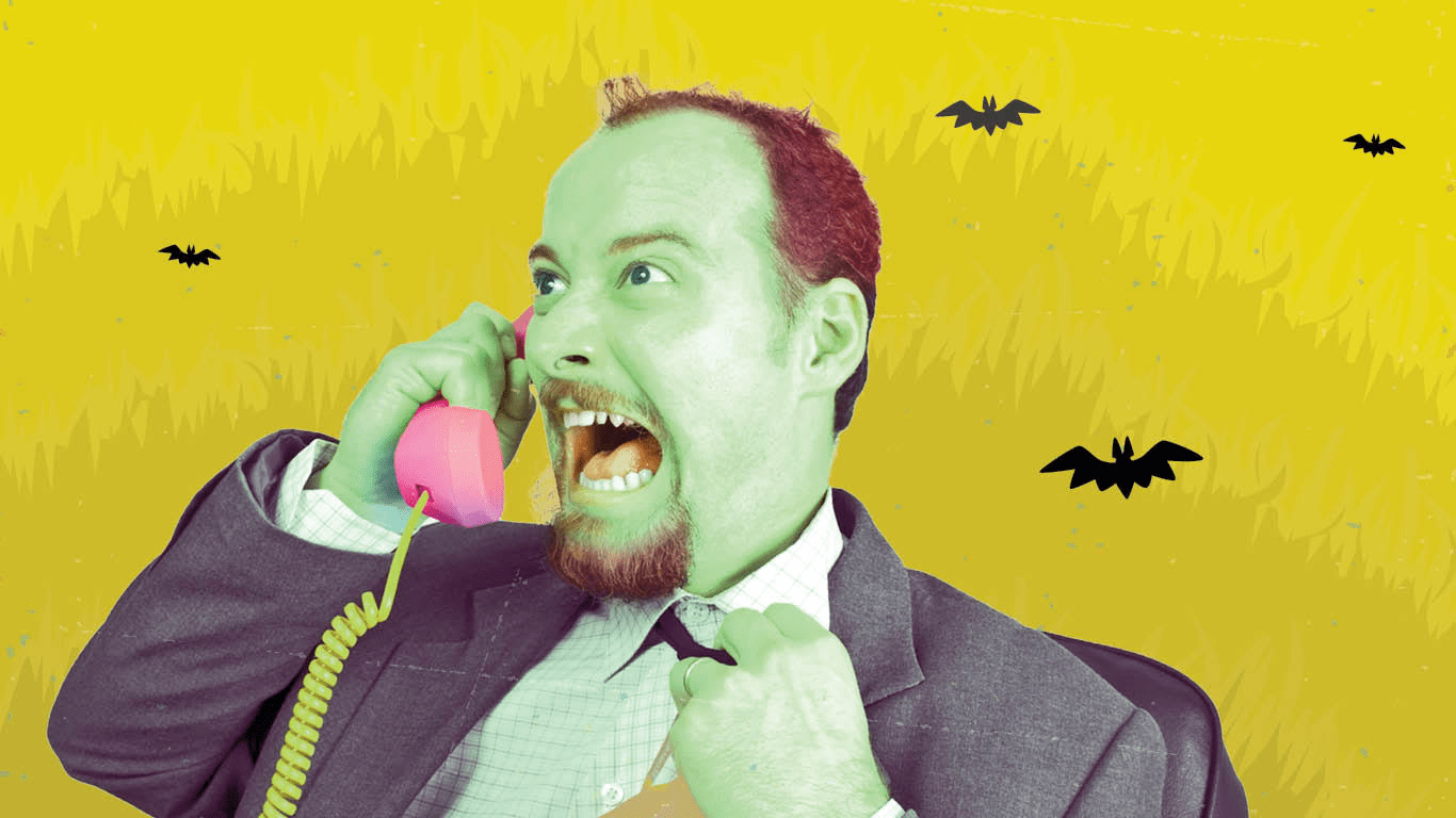 Angry man yelling into phone.