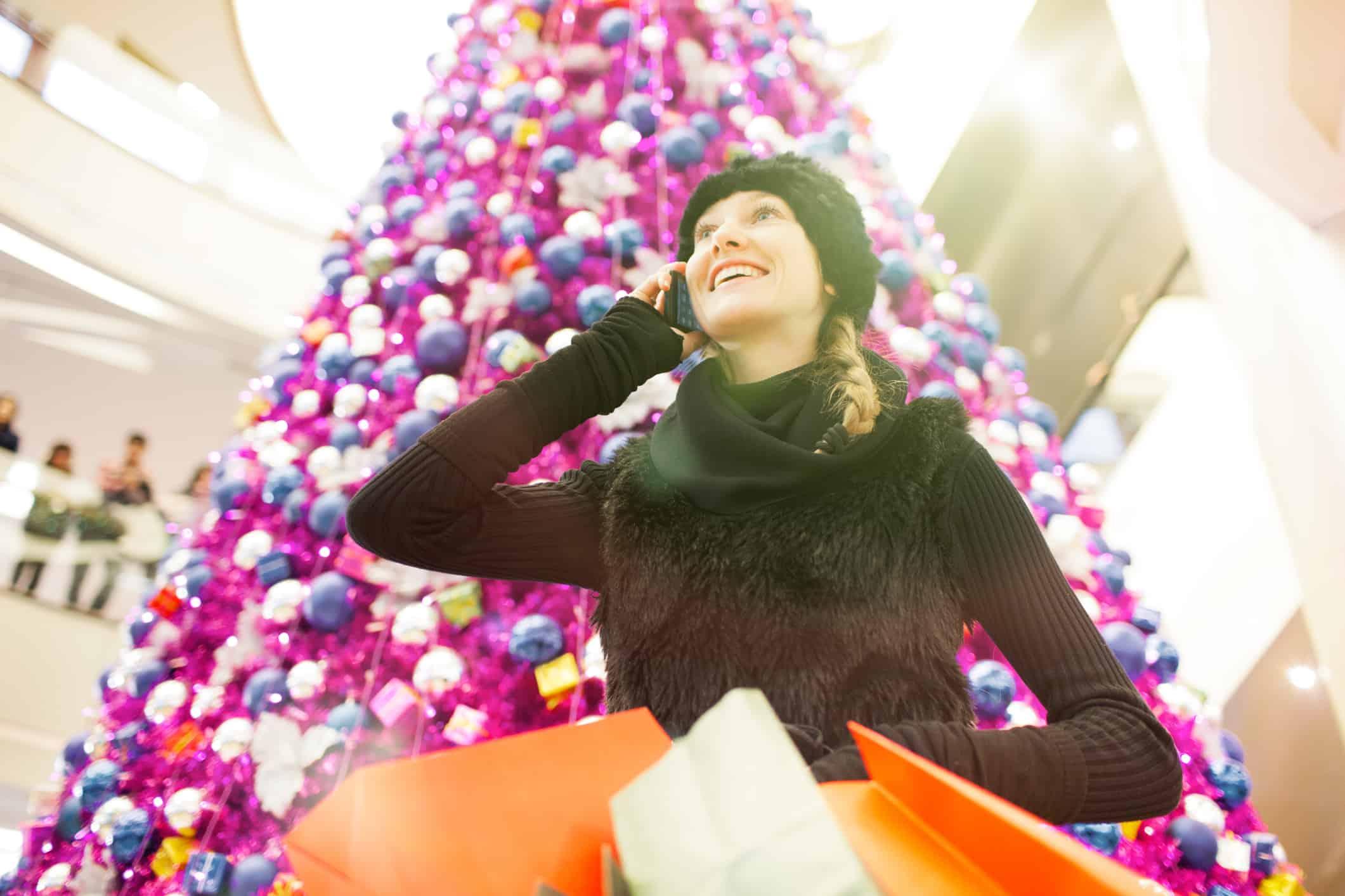 Beautiful woman christmas shopping.