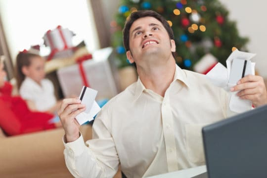Man frustrated with his family's Christmas bills and debt.