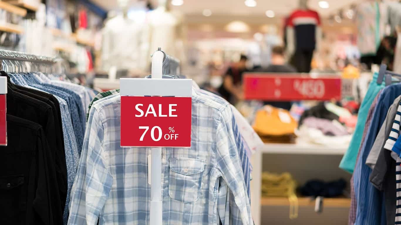 Sale shopping season,sale 70% off label sign sticker in front of shirt shop.