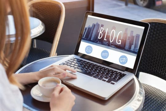 Blogging woman reading blog
