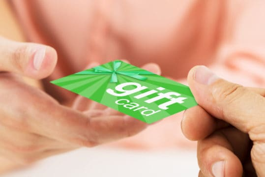 Close-up Of Person Hands Giving Blank Visiting Card To Another Person