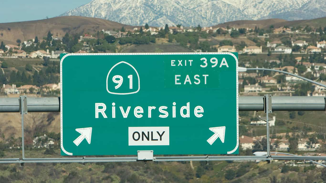 Highway exit sign with mountains behind, Riverside California