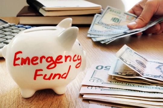 Emergency fund written on a piggy bank