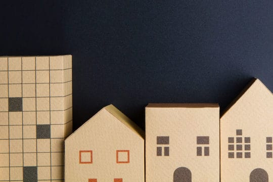 Home architectural model paper box cubes on black background