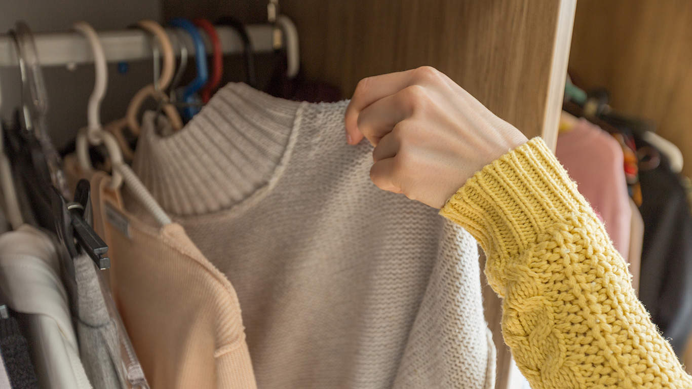 Woman's Hands Selecting Clothes