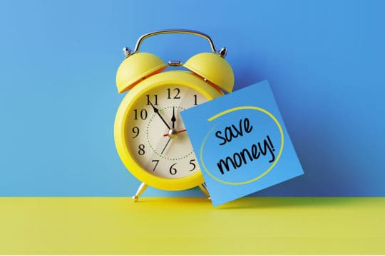 Alarm Clock And A Blue Post It Not Over Blue Background