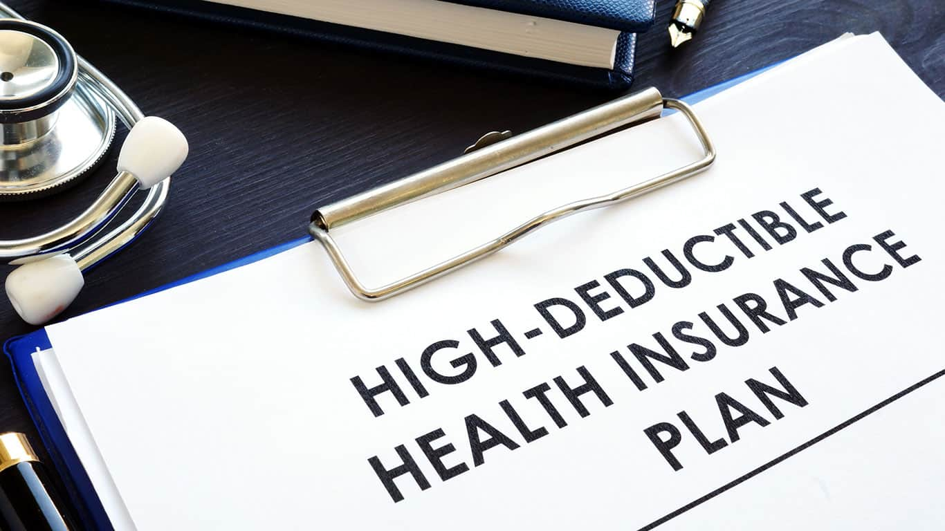 High-deductible health insurance plan HDHP on a desk