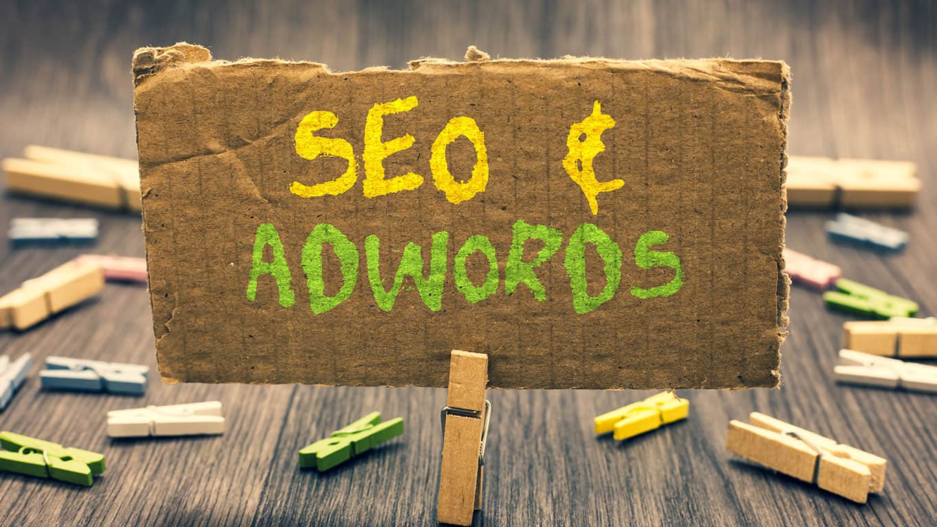 riting note showing Seo and Adwords. Business photo showcasing Pay per click Digital marketing Google Adsense