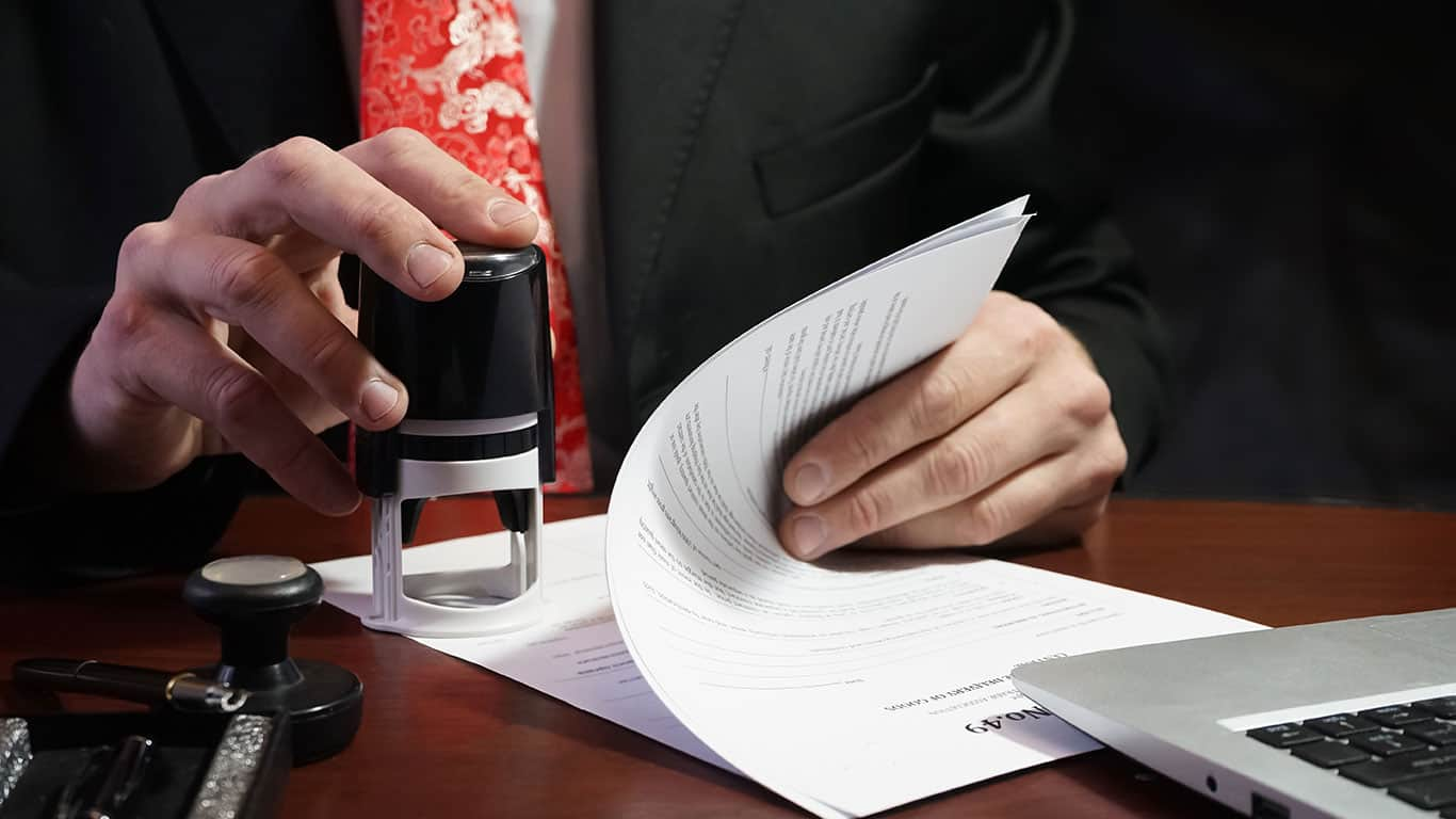 The businessman puts a stamp on the contract