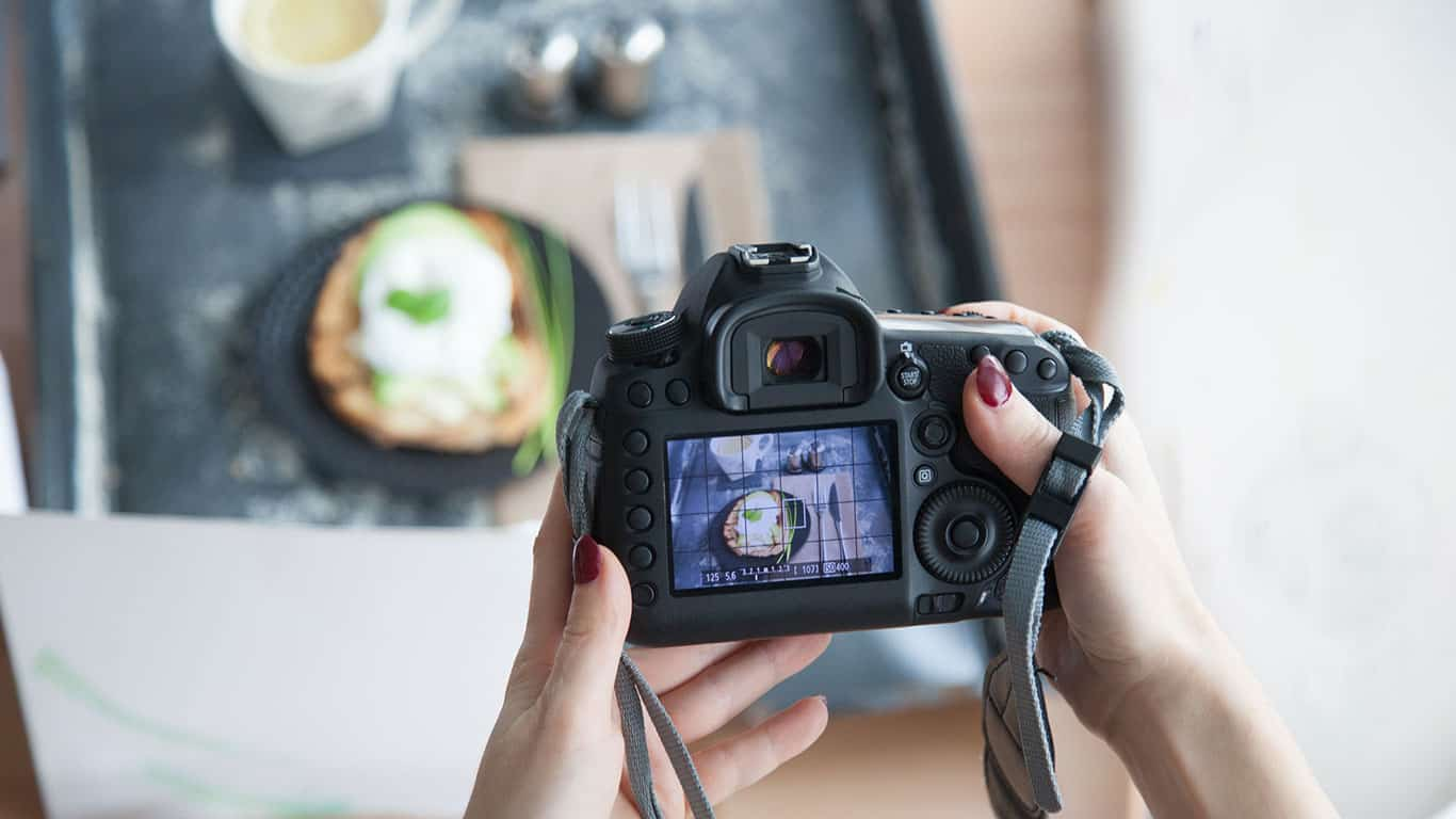 Female hands taking picture of breakfast table set up