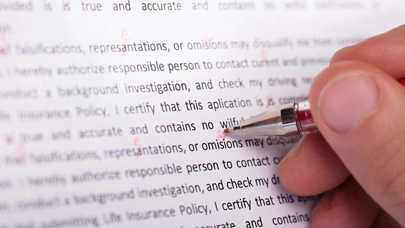 Person's Hand Marking Error During Spellchecking Text
