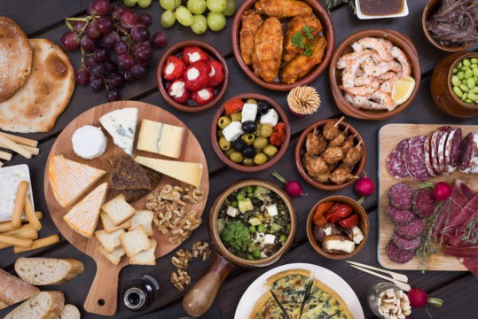Make party spreads potluck to spread out the cost of a big meal