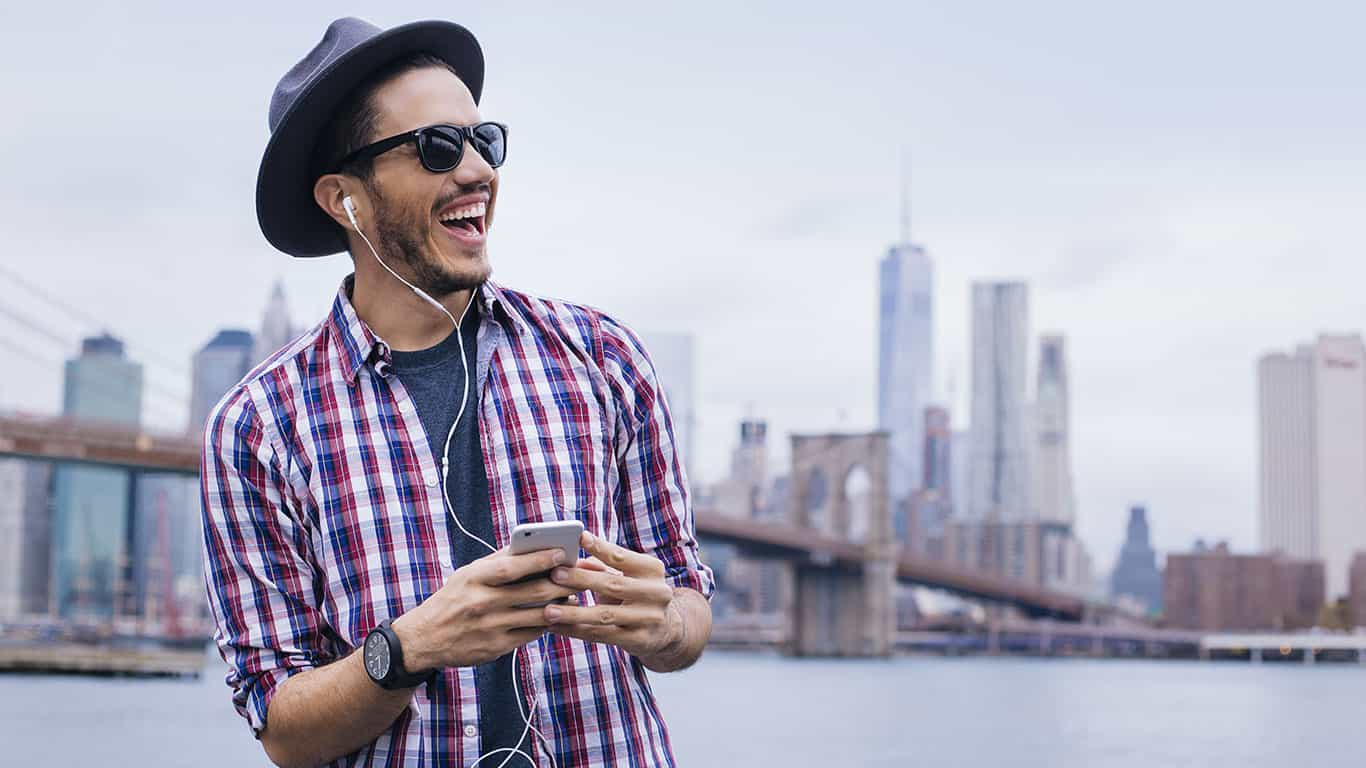Man listening music with his smartphone in Brooklyn