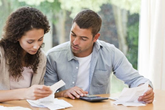 married filing separately student loan default; couple reviewing tax papers