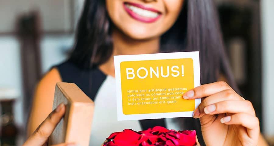 Woman showing a bonus card