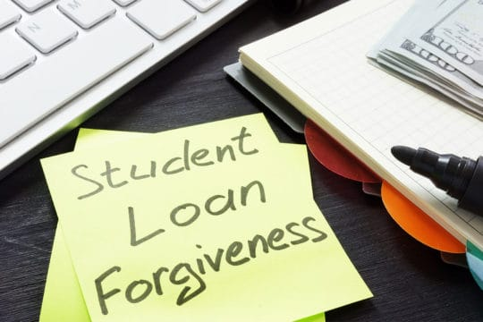 public service loan forgiveness qualifying payments; Student loan forgiveness written on a memo stick