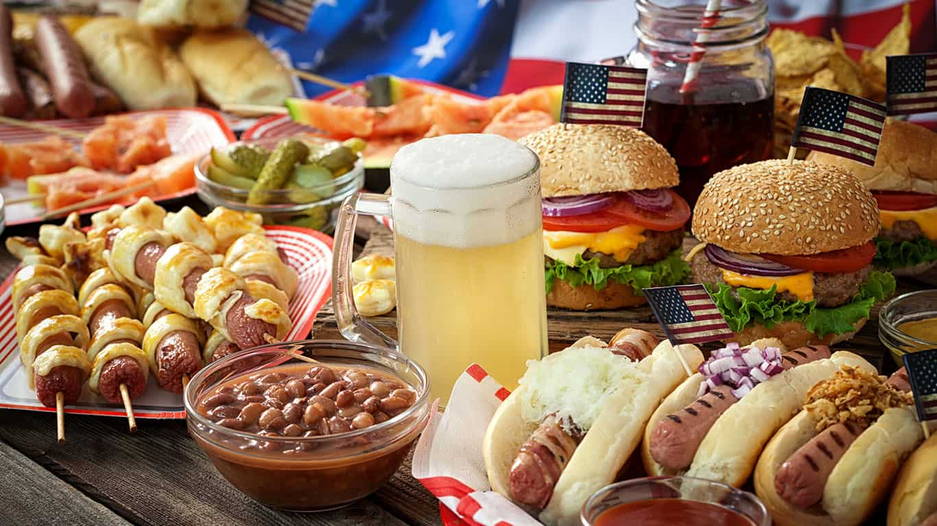 American Picnic Table with burgers and hot dogs for holiday 4th of July