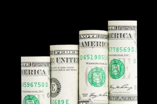 Growing bar graph from US dollar banknotes