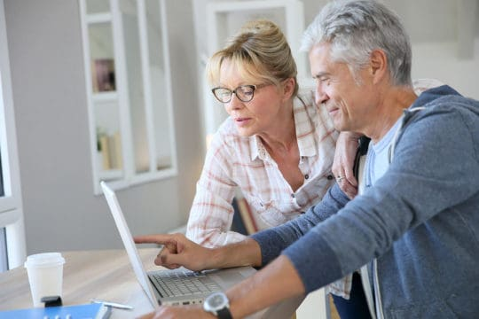 Couple looking at computer screen