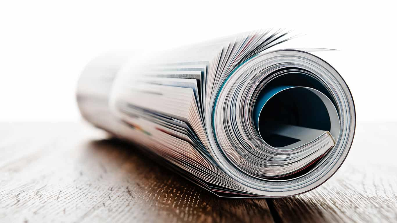 Magazine roll on wooden desk