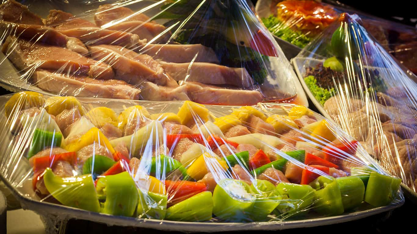 Decoration and raw foods that are wrapped with plastic wrap prepared for the wedding dinner party