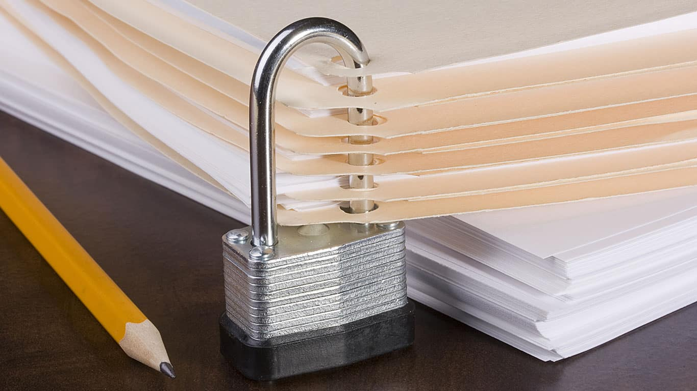 Stack of folders closed by a metal lock