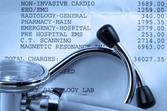 do medical bills affect your credit; stethoscope on top of paper medical bill