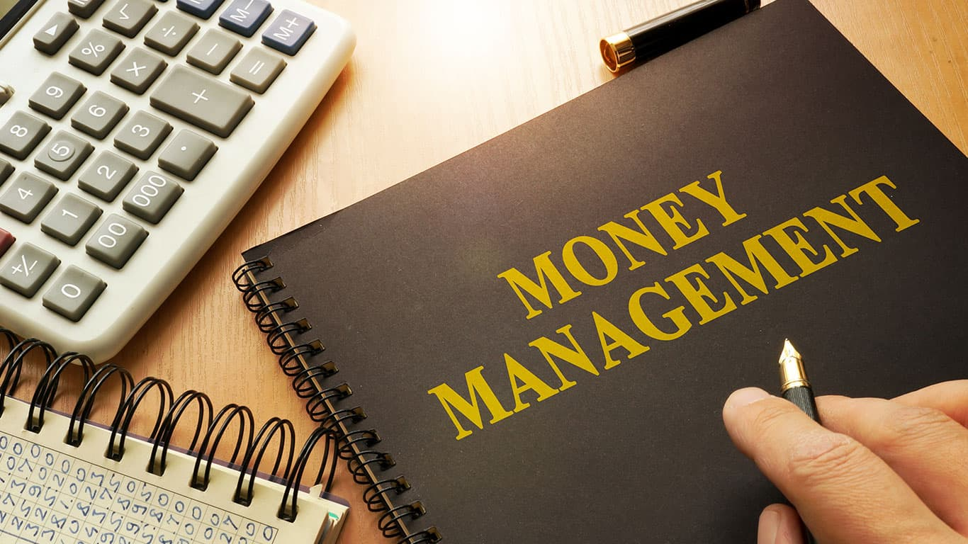 Book with money management on a table