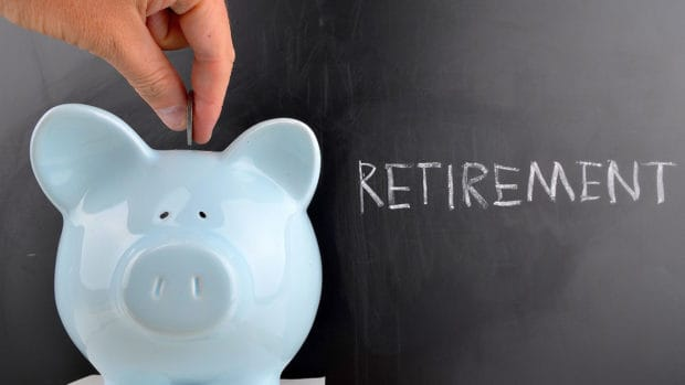 saving for retirement; blue piggy bank with retirement written on chalkboard