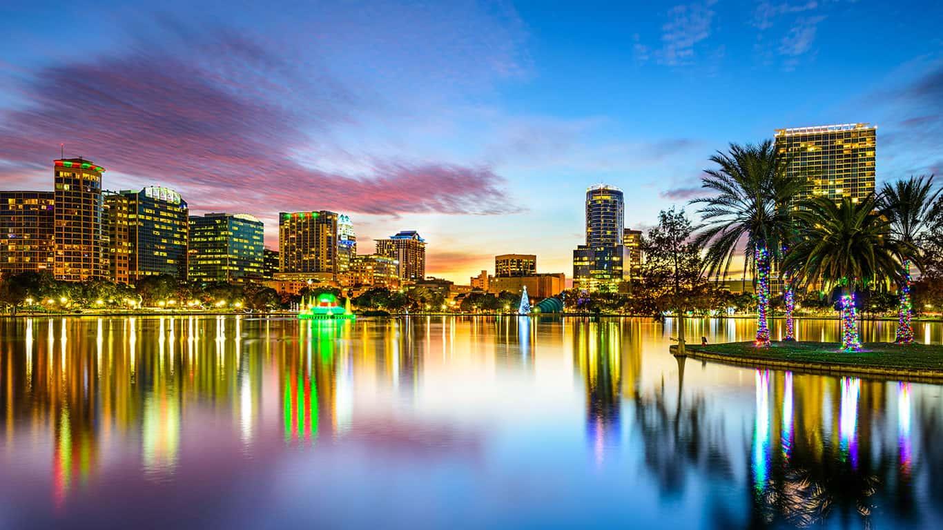 Orlando, Florida, USA downtown city skyline on Eola Lake
