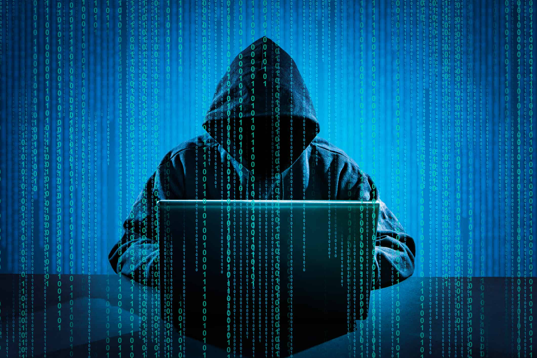types of identity theft; sinister hacker on computer