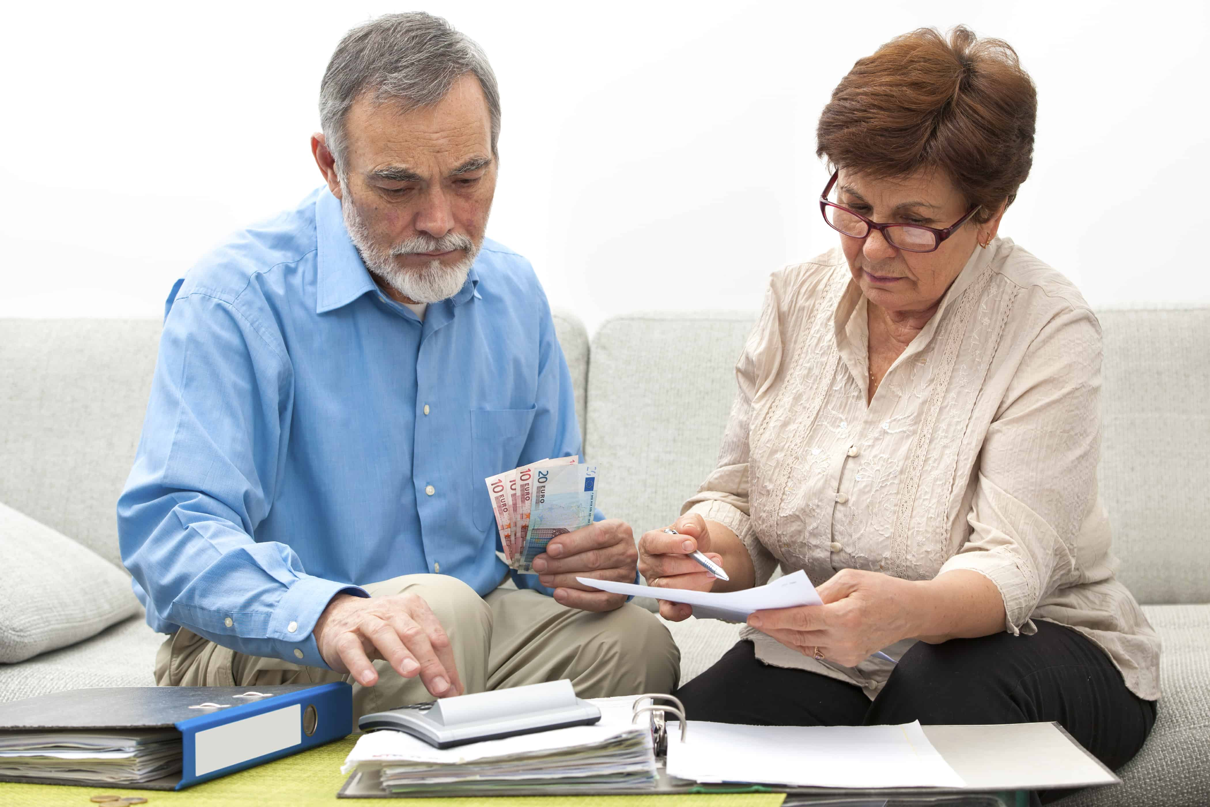 debt settlement and taxes; senior couple worrying about their money situation
