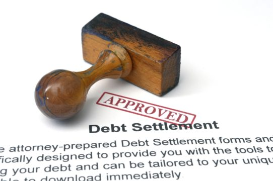 how to settle credit card debt; debt settlement papers with an approved stamp