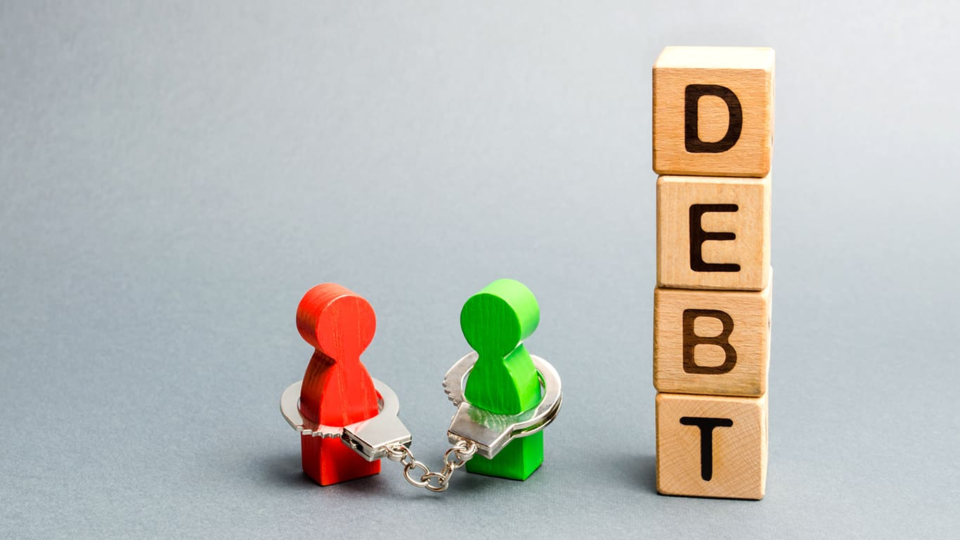 Two people are bound by handcuffs with the word Debt. Creditor and debtor